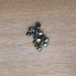 Remaches estrella oro viejo y níquel negro